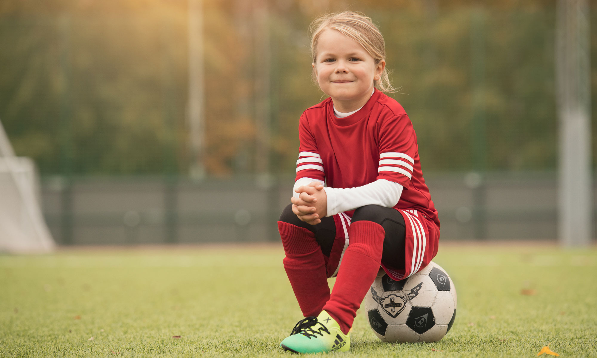 Child sitting on a football